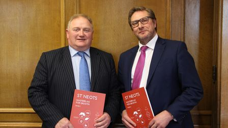 Cllr Charles Roberts (left) and Mayor James Palmer (right) with copies of the first Market Town Mast