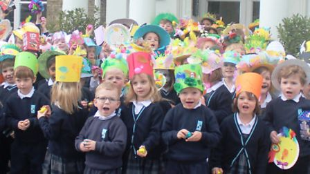 The youngest pupils at King's Ely outside Acremont and Nursery in their Easter bonnets.