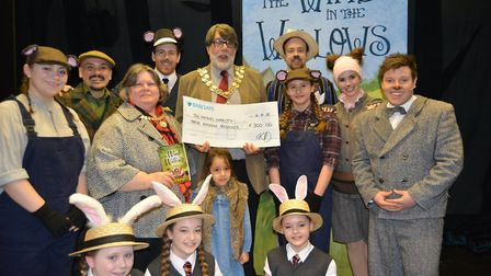 The Mayor and Mayoress with their granddaughter accept a cheque from KD Theatre for the Mayor's char