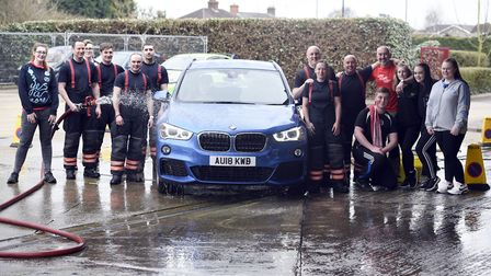 Wisbech fire fighters take on charity car wash outside the station