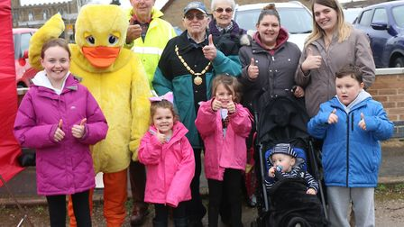 Whittlesey Duck Race, Easter Monday: PHOTO: RWT Photography The winners photo with Whitt the Duck ,