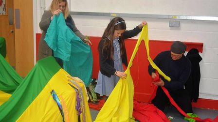 Enthusiastic helpers putting the final touches to the celebrity 'eel' that features so prominently i