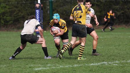 Ely Tigers give their best performance of the season against Holt. Tom Holloway looks to get through