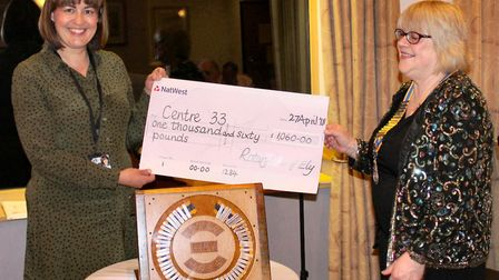 Ely Rotary Club president Viv Doji giving the cheque for £1,060 to Natalie Gildersleeve of Centre 33