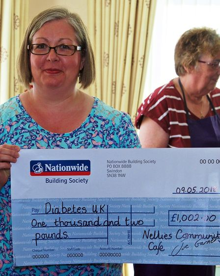 Nellie's cheque for £1,002 presented to Helen Strong of Diabetes UK.