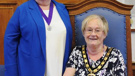 Cllr Kay Mayor (seated) re-elected chairman of Fenland Council. Her new deputy is Cllr Maureen Davie