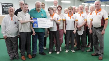 Members of the Fens Disabled Bowls Association. Whittlesey organiser Ray Hunt is far right