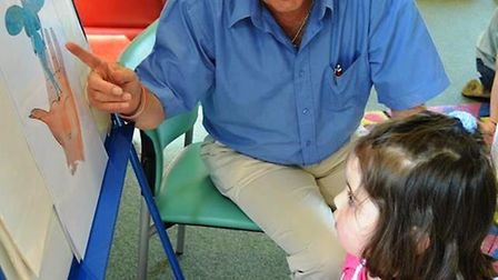 Children enjoying Ely Library's storytelling session with local author and illustrator Peter Crussel
