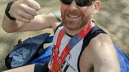 Three Counties Running Club's Phil Newton after completing the hottest London Marathon to date.