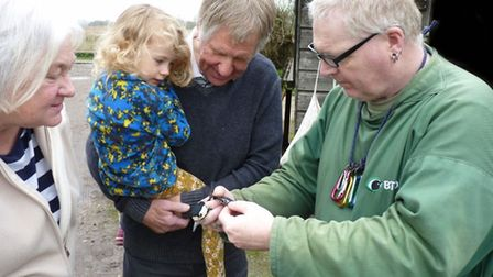 Chris Quy (pictured right), from the Wicken Fen Bird Ringers group with visitors at Wicken Fen.