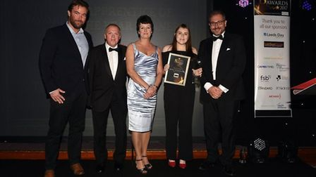 Abbie Davis (second right) of The Cornerstone Practice collecting the apprentice of the year award f