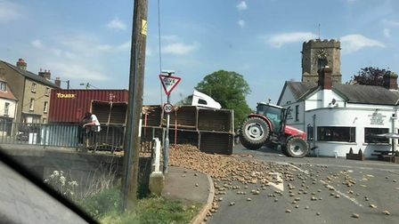 """Witnesses advise """"be careful"""" after an accident involving a tractor has caused hundreds of potatoes"""