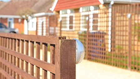 A neighbourhood dispute has erupted over a wooden fence that suddenly sprouted up outside a 68-year-