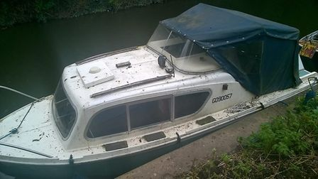 The boat has been left unattended on the River Nene in March.