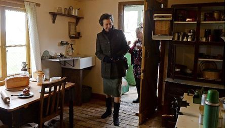 HRH Princess Anne enters the kitchen of Walnut Cottage followed by museum manager Ann Wise.
