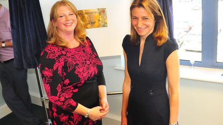 Melinda Smith (left) with Lucy Frazer (right) unveiling the new office plaque - Fraser Dawbarns soli