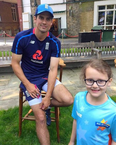 Gracie with Alistair Cook