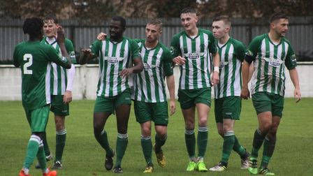 Gary Cohen, third left, celebrates after scoring for Soham Town Rangers against Canvey Island last s