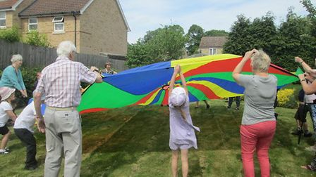 Bug hunting, hand printing, singing nursery rhymes, parachute games and a picnic were some of the ac