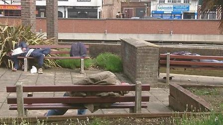 Photo of these men asleep on benches near the town centre provoked a storm when it was published to