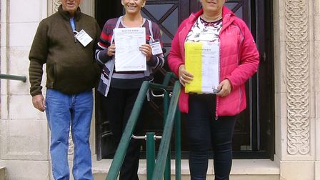 Alan Dougall, Kathy Dougall and Patricia Manning hand in the petition at Shire Hall