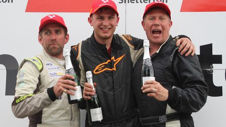 Lee Deegan (centre) celebrates with rival drivers Kane Astin (left) and Rupert Deeth (right). Pictur