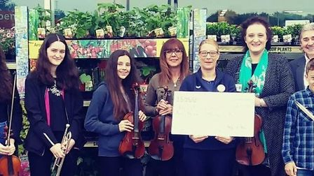 Members of Fenland Music Centre Association with Tesco community champion Kelly Riddell who presente