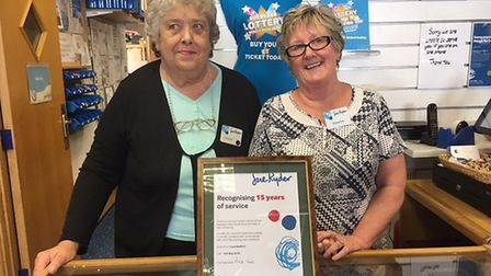 Betty Gray and Joyce Bedford with their award for 15 years of volunteering at the Sue Ryder charity