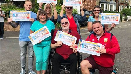 Stunned March residents as they each won £30,000 in the People's Postcode Lottery. PHOTO: Facebook /