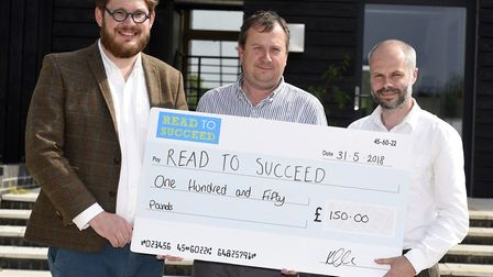 Read to Succeed donation by Swann Edwards left to right James Burton, Gareth Edwards adn Russell Swa