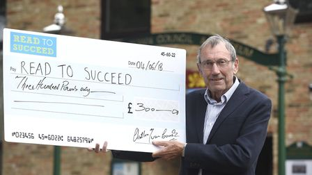 Mayor of Chatteris, Cllr Bill Haggata, with Chatteris Town Council's donation to the Read to Succeed