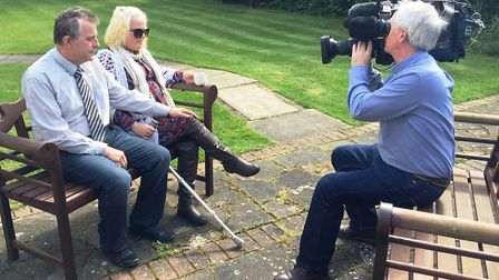Gary and Ruth Neave being interviewed outside the Cambs Times newspaper office