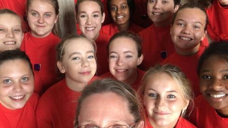 The Ely Cathedral Girls' Choir with their director Sarah Macdonald. PHOTO: King's Ely