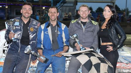 Ely's Carl Waterfield following his final victory on Saturday night flanked with placemen Lee Sampso