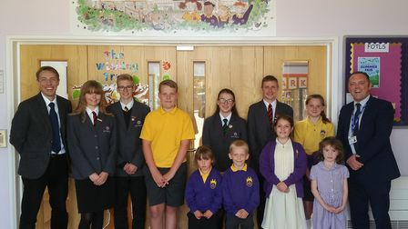 Students from Ely College and Lantern Community Primary School with headteacher designate of Lantern