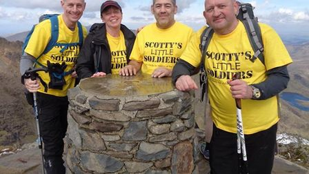 Simon Whittaker of March has returned from Mount Snowdon with more than £3,000 for local charity Sco