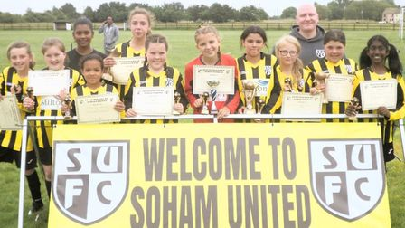 The Soham United FC U11 girls team at their presentation evening with managers Accia and Steve Sharp