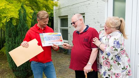 John Searle and wife Dianne delighted with their prize - Eight Norwood Road residents each won 30,00