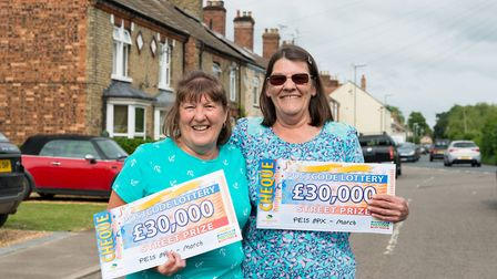 Sisters Bridget Davies and Pamela Wright with their prize - Eight Norwood Road residents each won 30