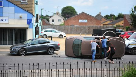 Two cars have crashed – one flipped on its side – in March this afternoon (June 13) PHOTO: Harry Rut