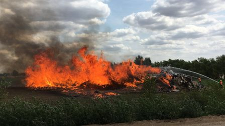 Twenty-five firefighters were called to a large pallet fire on the A10 at Chittering on July 19. The