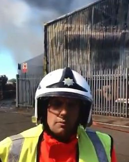 Station commander Jamie Johnson at the scene of today's factory fire in Wisbech