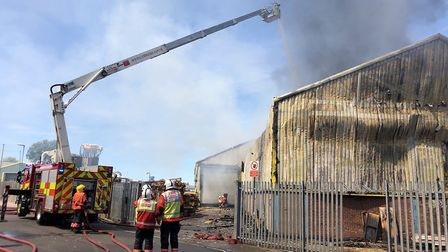 Fire crews remain at the scene in Brigstock Road this morning (June 25)