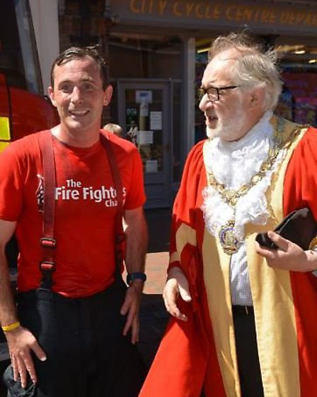Mayor Mike Rouse welcomed firefighter Duncan Fraser at the end of a 75 mile challenge for charity. D