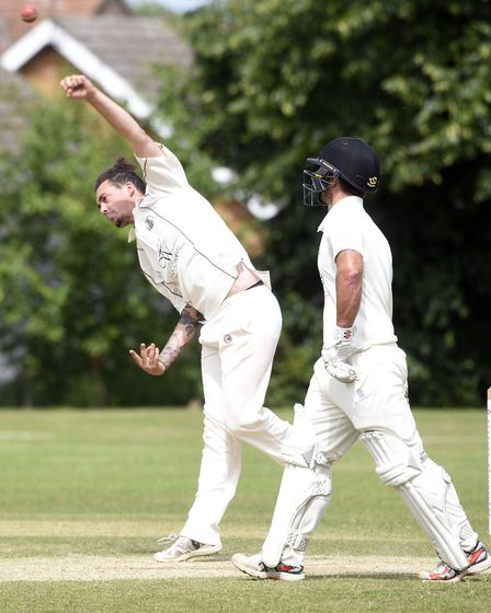 Spencer Saberton sends down a delivery during March's victory against Sawston & Babraham. Picture: I