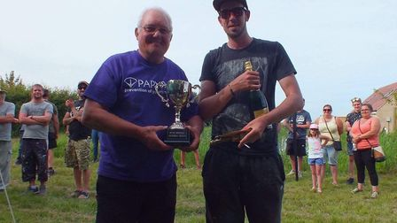 Paul Mainwaring (Ricky's Step Dad) with the winner - A charity fishing match held in memory of Ricky