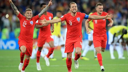 England's Harry Kane and team mates celebrate winning the penalty shoot out during the FIFA World Cu