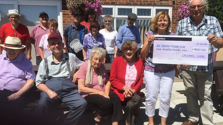 Pictured are Cheryl Payne and Brian Sutton together with members of the Tuesday Club outside of the