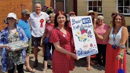 Celebrating 70 years of the NHS - the card was presented by Euro MP Alex Mayer last Saturday (July