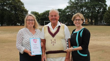 Brian Leonard, centre, was named Ely Hero Awards' sporting hero. He is pictured with Leah McMullan (